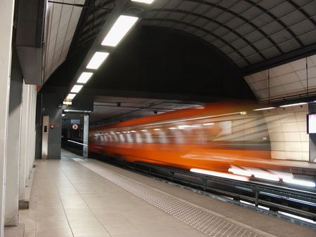 Orange subway leaving the station taken a slow speed Stock Photo