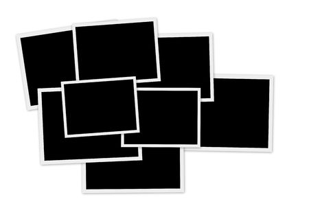 Pile of empty photo frames on white background