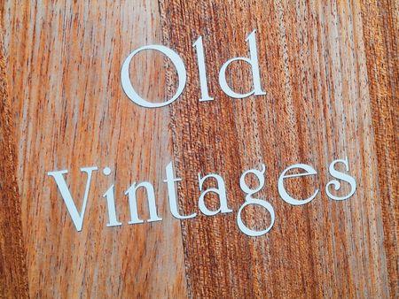 vintages: Old vintages in white letter written on wood panel