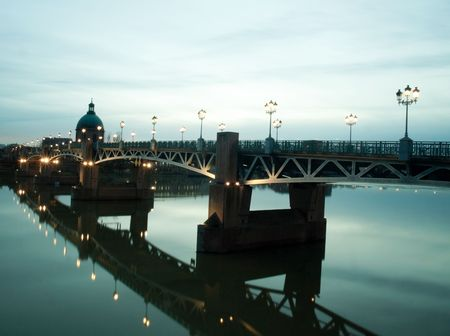 Pont Saint Pierre bridge over the garonne in the city of Toulouse in France at dusk