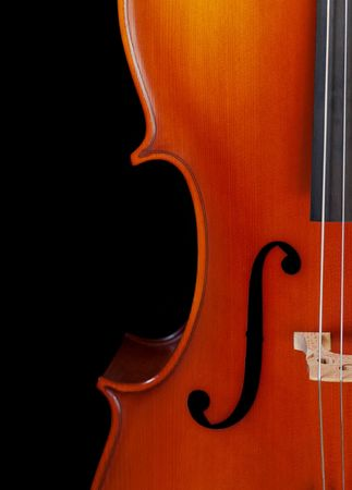 Closeup of a cello isolated on black