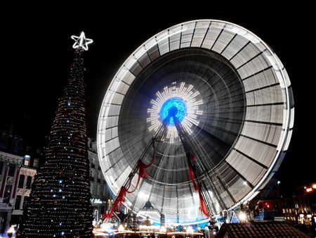 Ferris wheel during christmas in the city center of Lille in France
