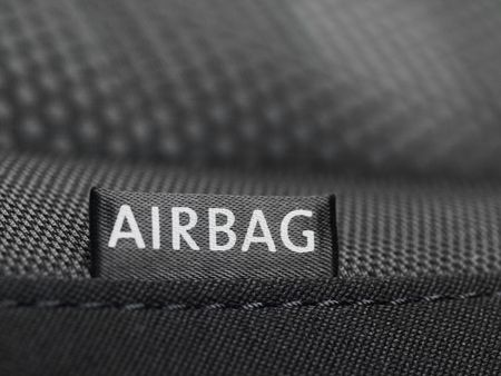 Detail of an airbag label on the side of a car seat photo