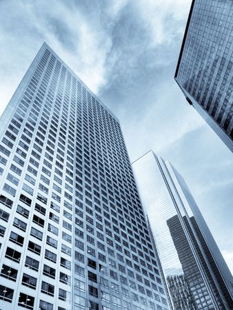 Modern group of skyscrapers soaring to the sky photo