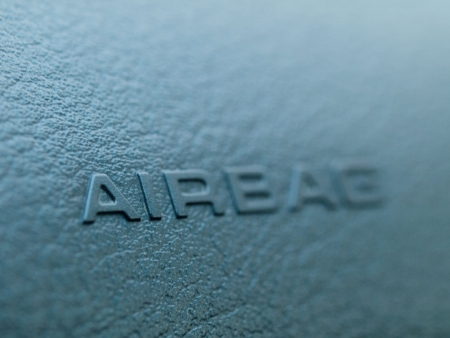 airbag: macro of an airbag sign on a dashboard with selective focus