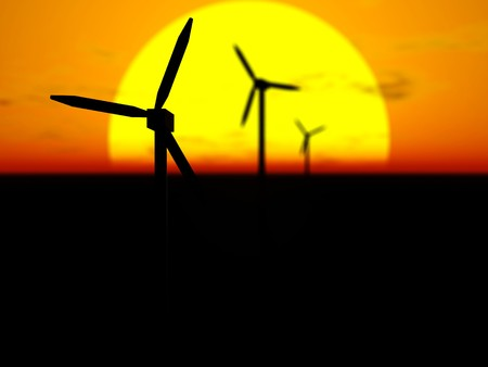 3D rendering of wind turbines in front of the sun disc at sunset with selective focus Stock Photo - 6981495