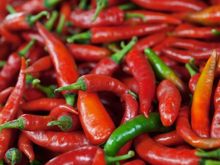 Close up of a pile of red chili peppers in a market in Malaysia
