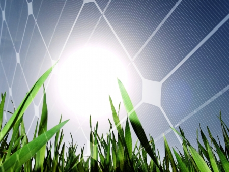 photon: Fresh green grass field against the sun with solar panel