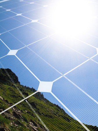 Mountain top with shining sun and photovoltaic panel