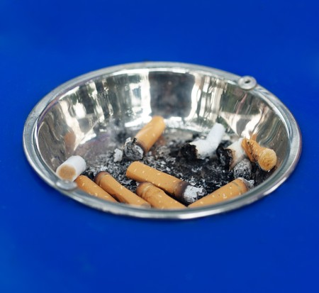 discarded metal: Cigarette butts  in a metal  public ashtray Stock Photo