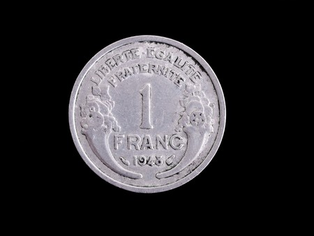 franc: Vintage half  French Franc coin isolated on black
