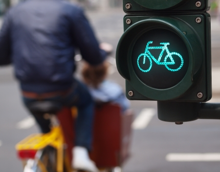 city bike: Bicycle sign on a traffic light