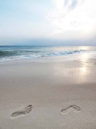Footprints on beach photo