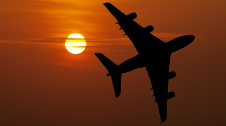 Airliner over red sunset photo