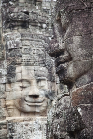 bayon: Faces carved in stone in  Bayon temple   in Angkor Thom Cambodia  Bayon temple was built late 12th century under king  Jayavarman VII Stock Photo
