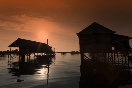tonle sap: slilt houses in the evening at tonle sap lake in Cambodia Stock Photo