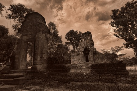 thom: Temple ruins in the old city of Angkor Thom cambodia