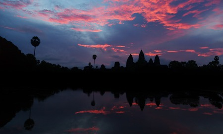 Beautiful sunrise at Angkor Wat temple with reflection on water