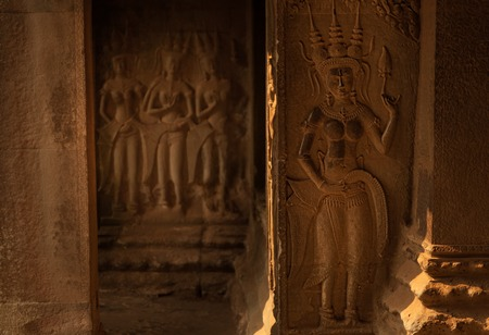 Devata statues in Angkor Wat in the morning light Stock Photo