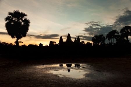Beautiful sunrise at Angkor Wat temple temple with water reflection