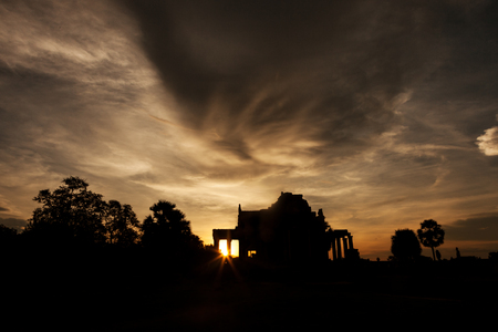 Beautiful sunrise at Angkor Wat through one of the library