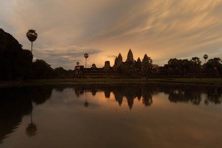 Beautiful sunset at Angkor Wat temple with water reflection Stock Photo