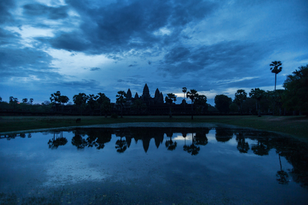 Beautiful blue sunrise at Angkor Wat temple with water reflection Stock Photo