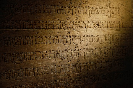 Sanskrit writing carved in sandstone in Angkor temple