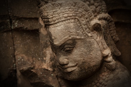 Buddha statue carved in sandstone at the terrace of the leper king in Angkor