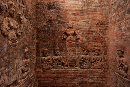 Brick bas relied at Prasat Kravan temple in Angkor Stock Photo