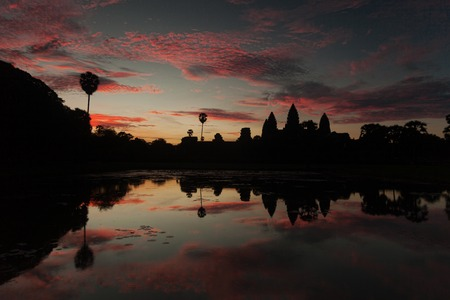 Beautiful sunrise at Angkor Wat temple with water reflection