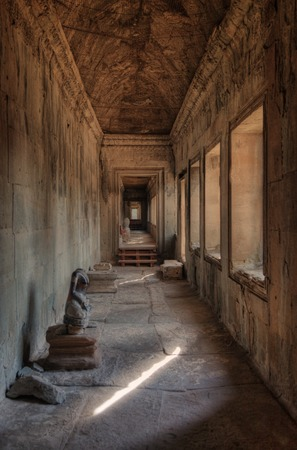 Corridor with morning light shadows in Angkor Wat temple Stock Photo