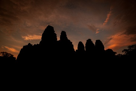 Bayon temple silhouette at dusk Stock Photo