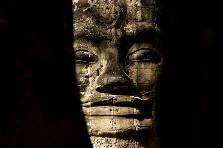 One of the many stones faces in Angkor Thom in siem reap Cambodia Stock Photo