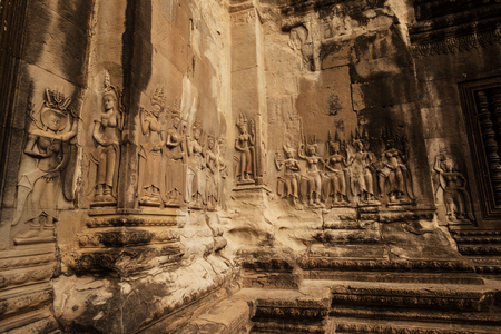 Group of devata carvings in Angkor Wat temple