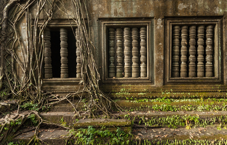 Windows with overgrown jungle in the temple of Beng Mealea near Siem Reap Cambodia