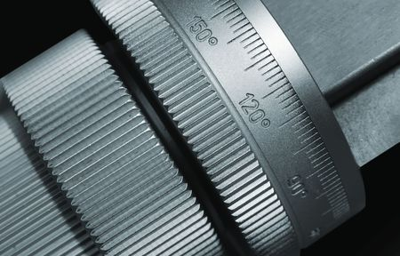 micrometer: micrometer as part of  cutting machine. Close up view.
