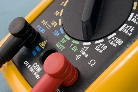multimeter: yellow multimeter close up. electronics instruments and tools.