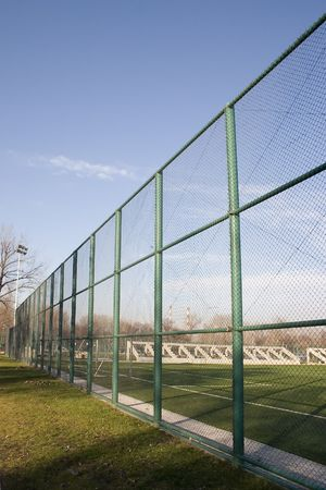 wire fence around a football playground in the morning. Stock Photo - 2989095