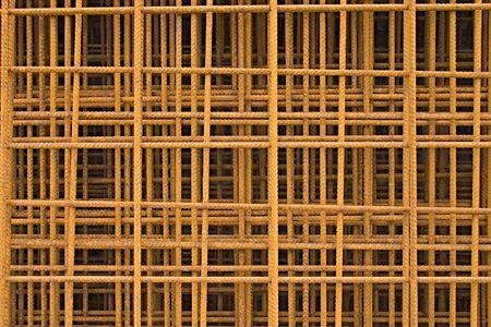 rebar: rusty grid of steel rebar for reinforced concrete.