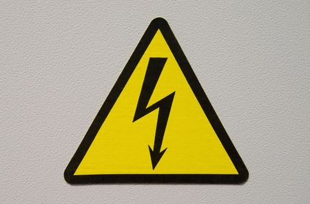 high voltage sign on white metal plate photo