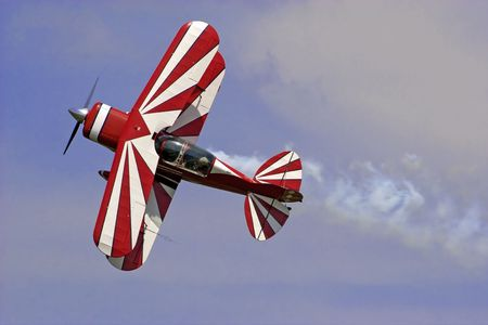 propellers: a red-white  biplane at an air show.