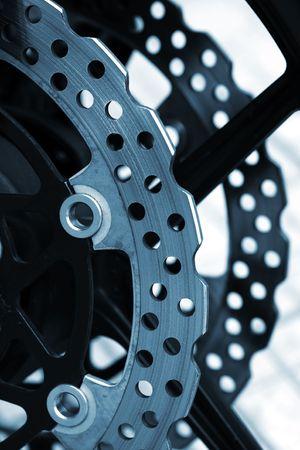 Closeup detail of a racing motorcycles brake disc.