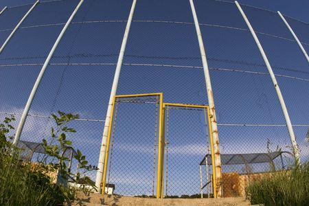 Wire fence and gate of local football  playground. Stock Photo - 3338790