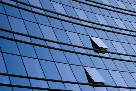 modernity: modern office building glass wall and two windows Stock Photo