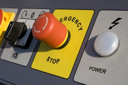 emergency stop and power switch on motor control panel.