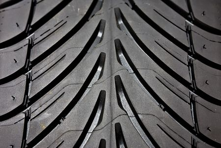 A close-up shot of the tread on a tyre. photo