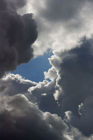 The clear blue hole in storm clouds. Stock Photo - 6751747