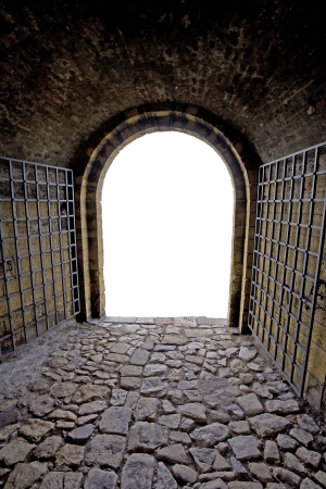 Brick tunnel with gate. Isolated exit. Stock Photo - 7602659