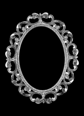 isolated silver frame on a black background. photo
